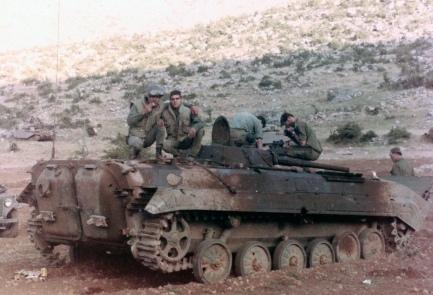 Солдаты АОИ рассматривают подбитую БМП. 1982 Южный Ливан.