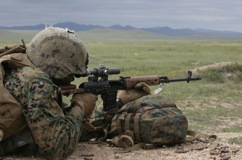 U.S. Marines fire a Dragunov SVD sniper rifle provided by the Mongolian armed forces as part of Khaan Quest 2009 at the Five Hills Training Area in Mongolia Aug. 14, 2009. The Marines and Mongolians are exchanging knowledge about their respective weapon systems. (U.S. Marine Corps photo by Lance Cpl. Nathan McCord/Released)