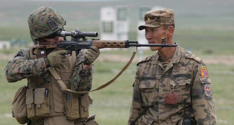 Royal Moroccan Army Sgt. Gantumur, crouching, teaches U.S. Marine Corps Lance Cpl. Edgar how to fire the SVD sniper rifle at the Five Hills Training Center near Ulaanbaatar, Mongolia, Aug. 1, 2007, during weapons familiarization training as part of Exercise Khaan Quest 2007. (U.S. Marine Corps photo by Cpl. Dustin T. Schalue/Released)