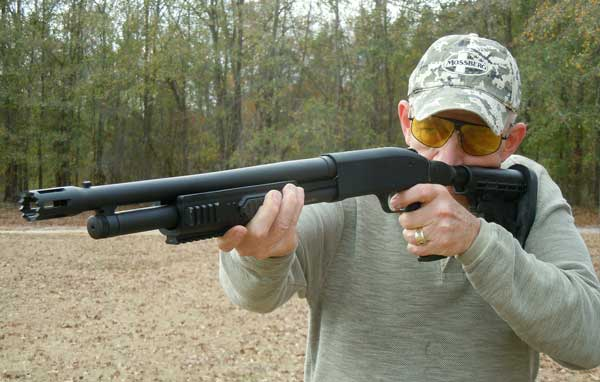 Fighting Flex: The author tries his hand with a collapsible stock/breaching barrel setup.