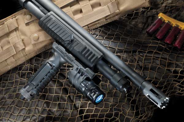 The railed tactical-style fore-end will accomodate vertical foregrips with lights, such as this SureFire unit.