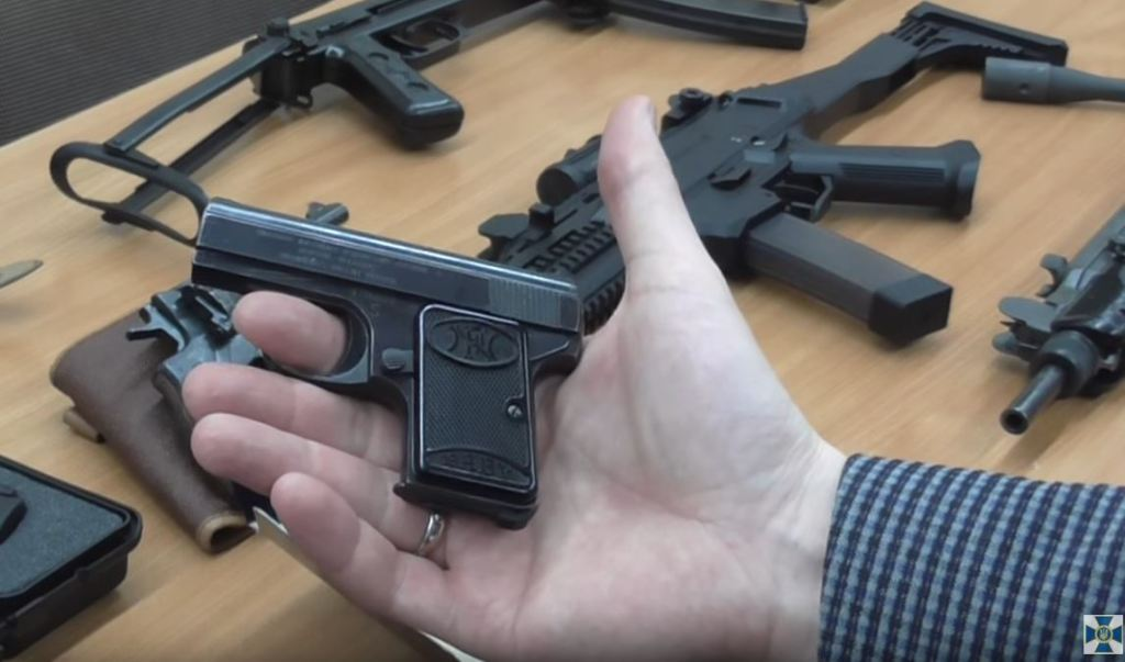 "Small FN pistol ""Baby"", possibly this one, and the CZ Evo 3 and an Uzi in the background."