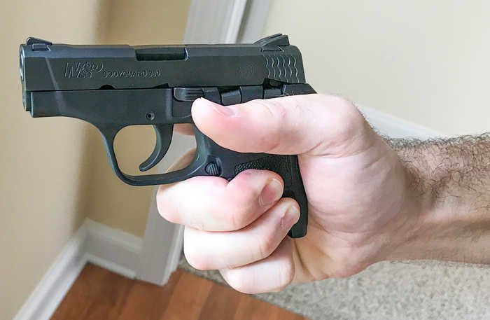 How to hold a small pistol with large hands